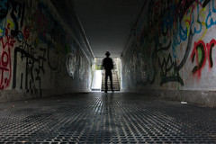 (i k o) Tags: camera longexposure motion blur wet hat silhouette underpass graffiti sony 28mm tunnel dirty pocket controluce compact spraypainting cappello selftimer carlzeiss sottopassaggio rx100 variosonnart 28100mmf1849