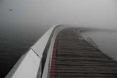 The Walkway on the Bay (Alain Martineau) Tags: morning sea blackandwhite cloud mer white mist black fog clouds bay australia victoria geelong australie baie corio