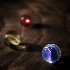 Big Blue (Alan Drake) Tags: blue light red 3 abstract colour macro glass yellow digital nikon rust experimental marbles manual marble d7000