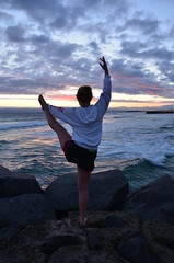 stretch (Lilly Crosby) Tags: life california sunset beach water yoga clouds nikon rocks waves sister stretch d7000