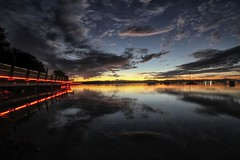 Leading Lights (pominoz) Tags: sunset red lake reflection clouds lights walkway nsw lakemacquarie eleebana