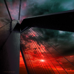 Bridge to Hell - Emotions of Steel (mrtungsten62-ON/OFF) Tags: sunset sky sun holland metal clouds dark evening rotterdam nikon europe fireworks steel thenetherlands police topf300 redsky tourdefrance jackiechan tension emotions topf100 redbull djtiesto erasmusbridge airrace basculebridge steelcables atouchofhdr mrtungsten62 frankvandongen shockdampers