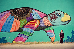 The Boy and the Turtle (Allard Schager) Tags: street boy streetart vintage mexico graffiti spring nikon mural schildpad artistic turtle character streetphotography vivid wallart retro april bajacalifornia tijuana colourful creature lente iconic schoolboy goldcoast toning 2013 metropolitanarea d700 nikond700 playasderosarito nikonfx allardone allard1 nikkor70200mmf28vrii allardschagercom