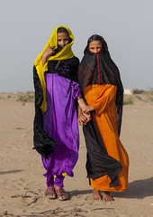 Rashaida Tribe Girls, Port Sudan, Sudan (Eric Lafforgue) Tags: africa portrait vertical outdoors photography women day child veiled veil northafrica soedan sudan tribal arab teenager tribe multicolored niqab saudiarabia 2people twopeople soudan northernafrica traditionalclothing realpeople traveldestinations colorimage lookingatcamera portsudan fulllenght childrenonly  szudn sudo  northernsudan northsudan     banirasheed rashaayda  xuan ert7889