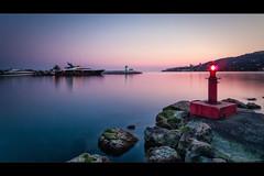Golf Juan Port - France (jeff_006) Tags: light sunset sea lighthouse seascape france water rock landscape pier boat moss long exposure mediterranean yacht rich olympus zuiko 918 f456 em5 flickrsfinestimages1 flickrsfinestimages2