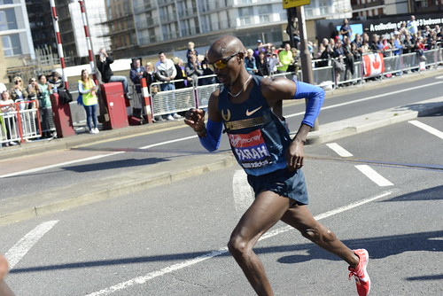 Mo Farah runs across Deptford Bridge