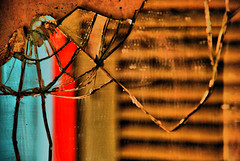 Through a broken mirror (jimiliop) Tags: door red brown color colour reflection broken glass wall mirror decay cyan cracks destructed bestcapturesaoi