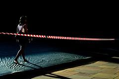 . (ferriswhiskey) Tags: street light shadow woman grass walking sydney streetphotography off tape cover fujifilm universityofsydney usyd cordoned xpro1