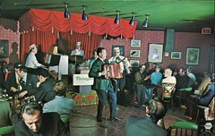 """Lively Entertainment at """"Flanagan's"""", Holiday Inn, Toronto ON (SwellMap) Tags: vintage pc 60s fifties puppet postcard lounge kitsch personality retro nightclub christian odd chrome singer actor eccentric entertainer 50s unusual tacky roadside oddball wacky sixties ventriloquist showman 15minutesoffame minorcelebrity"""