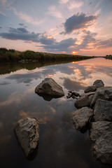 Natomas Sunset (boingyman.) Tags: california sunset seascape reflection vertical clouds landscape rocks sacramento scape waterscape natomas boingyman