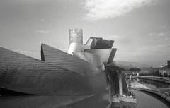 Guggenheim Museum Bilbao (pho-Tony) Tags: olympusxa4 ilfordhp5plus bilbao 35mm analogue olympus xa4 film xa ishootfilm filmisnotdead zuiko 28mm macro wide angle wideangle clamshell clam shell slide expired ilford hp5 plus rodinal guggenheim museum guggenheimmuseumbilbao guggenheimmuseum bilbo basque frank gehry frankgehry