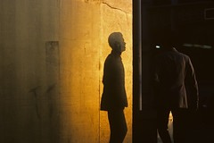 Silhouetted man along downtown street at sunset shadow on wall turning corner to cross street Seattle Washington State USA (Jim Corwin's PhotoStream) Tags: silhouetted silhouettes shadow wall sunset urban urbanscene downtown street streetscene mystery suit business oneperson alone quiet serenity peaceful solitude individual individuality lonely quietreflection meditating thinking photography horizontal isolation single contemplation city cities strange foreboding mysterious man men male walk walking sideofbuilding