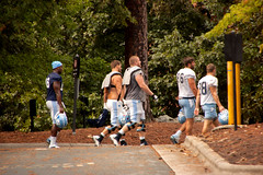 Last Practice (2) (tommaync) Tags: unc tarheels football players men theuniversityofnorthcarolina practice walking blue white trees pole yellow chapelhill nc northcarolina september 2016 nikon d40