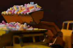 Piling on the Pounds (mitchell_dawn) Tags: loading digger excavator lorry truck dumptruck sugarstrands sprinkles sweets sweetspotsquared macromondays matchboxcars toys