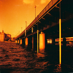 Lomography Redscale 100 (-ish) (nextstopbombay) Tags: lomography redscale square 6x6 mediumformat yellow red orange water bridge stockholm analogue film 120film c41