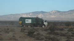 trash truck in the desert (ron.photographer) Tags: trash desert dump crap mojave mojavedesert californiacity wastemanagement trashtruck calcity deserttrash desertgarbage stuffinthedesert