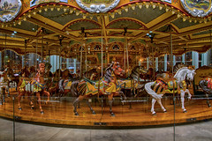 Dancing Carousel Horses (SunnyDazzled) Tags: park city nyc longexposure horses newyork art glass childhood brooklyn night reflections fun lights dance colorful cityscape ride landmark carousel amusementpark hdr janes layered manualblend