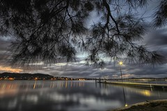 Overhang (pominoz) Tags: light lake tree lamp clouds sunrise pier jetty wharf nsw lakemacquarie marmongpoint