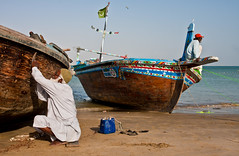 Citizens of Pakistan (Asian Development Bank) Tags: pakistan sea people man male beach nature work person boat sand asia masculine labor working human shore repair labour environment concept karachi sindh humanbeing activities rowboats pak skill watertransport