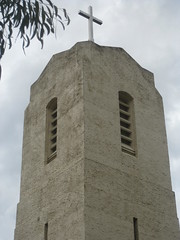 The Belfry of St Johns Anglican Church  Downey Street, Alexandra (raaen99) Tags: door roof roses flower building tree tower church window wall architecture facade garden tile concrete religious town leaf 1930s worship catholic exterior terracotta painted faith country religion entrance stjohns australia chapel victoria belltower doorway belfry alexandra porch catholicism 20thcentury grounds stainedglasswindow anglican stucco 30s 1937 anglicanchurch churchbuilding rooftile placeofworship spanishmission countryvictoria vestibule twentiethcentury countrytown hippedroof northeastvictoria religiousbuilding stjohnsanglicanchurch spanishmissionstyle spanishmissionarchitecture provincialvictoria georgepayne spanishmissionchurch terracottarooftile downeystreet architecturallydesigned lrwilliams spanishmissionbuilding downeyst theanglicanchurchofstjohn