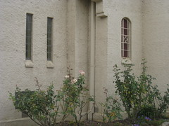 The Porch and Vestibule Windows of St Johns Anglican Church  Downey Street, Alexandra (raaen99) Tags: door roof roses flower building tree tower church window wall architecture facade garden tile concrete religious town leaf 1930s worship catholic exterior terracotta painted faith country religion entrance stjohns australia chapel victoria belltower doorway belfry alexandra porch catholicism 20thcentury grounds stainedglasswindow anglican stucco 30s 1937 anglicanchurch churchbuilding rooftile placeofworship spanishmission countryvictoria vestibule twentiethcentury countrytown hippedroof northeastvictoria religiousbuilding stjohnsanglicanchurch spanishmissionstyle spanishmissionarchitecture provincialvictoria georgepayne spanishmissionchurch terracottarooftile downeystreet architecturallydesigned lrwilliams spanishmissionbuilding downeyst alexandraanglicanchurch stjohnsalexandra theanglicanchurchofstjohn stuccoedconcrete