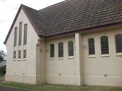 St Johns Anglican Church  Downey Street, Alexandra (raaen99) Tags: door roof roses flower building tree tower church window wall architecture facade garden tile concrete religious town leaf 1930s worship catholic exterior terracotta painted faith country religion entrance stjohns australia chapel victoria belltower doorway belfry alexandra porch catholicism 20thcentury grounds stainedglasswindow anglican stucco 30s 1937 anglicanchurch churchbuilding rooftile placeofworship spanishmission countryvictoria vestibule twentiethcentury countrytown hippedroof northeastvictoria religiousbuilding stjohnsanglicanchurch spanishmissionstyle spanishmissionarchitecture provincialvictoria georgepayne spanishmissionchurch terracottarooftile downeystreet architecturallydesigned lrwilliams spanishmissionbuilding downeyst alexandraanglicanchurch stjohnsalexandra theanglicanchurchofstjohn georgeapayne stuccoedconcrete