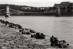 Shoes on the Danube Promenade (Darkelf Photography) Tags: city bridge blackandwhite bw sculpture art history monochrome canon river photography mono memorial shoes europe hungary wwii budapest chain cobblestone promenade jews danube maciek 2012 70200mm darkelf shoesonthedanubepromenade 5dii gornisiewicz