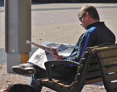 Reading the Paper (mikecogh) Tags: sun sunglasses bench reading newspaper relaxing olympicpark