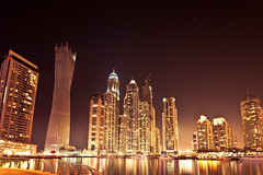Dubai Marina - Night glow (tobiviereinseins) Tags: world city trip travel winter light sunset urban orange lake holiday color detail reflection travelling tower beach yellow architecture modern night contrast canon photography eos lights town reisen holidays colorful exposure dubai fotografie sonnenuntergang nightshot angle nacht outdoor dusk centre wide sigma wideangle center abroad architektur colourful traveling capture effect kontrast vignette reise nachtaufnahme abstrakt welt nachts langzeitbelichtung longtime 10mm 450d