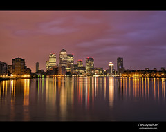 Canary Wharf Sunrise (esslingerphoto.com) Tags: city longexposure morning pink england reflection building london wet water thames architecture canon buildings reflections river photography eos pier photo europe cityscape shot britain district capital architectural single wharf 5d canary pinksky financial banking cityoflondon finance mkii esslinger esslingerphotocom esslingerphoto