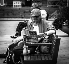 Reading the news (Henka69) Tags: reader reading newspaper stockholm streetphoto street bw monochrome sweden