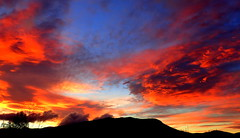 FIERY SKY over the MOUNTAIN (elliott.lani) Tags: skies tasmaniansunset colour color colourful vibrant beautiful bright mountain mountwellington kunanyi red orange blue black