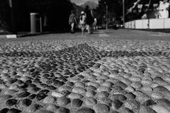 Walk this way (stefankamert) Tags: stefankamert street walkthisway way bw sw baw noiretblanc monochrome fujifilm fuji x100 x100s blackandwhite blackwhite schwarzweis arrow cobblestone