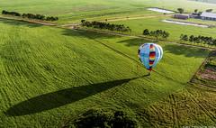Going Down (Priscila de Cássia) Tags: balloon flight nature landscape farm shadow sun green adventure balloonflight hotairballoon nikon nikond90 colorful highangle fields