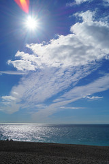 Flare (Rob Hall -) Tags: sunshine sunlight sun shine flare bright blue sky clouds cloud beach pebbles seaside seafront waves tide coastline coast shore warmth warm shoreline