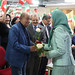 Maryam Rajavi offers flowers to political dignitaries at the celebration of the Relocation of Camp Liberty residents