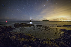 Penmon Starlight (Ffotograffiaeth Dylan Arnold Photography) Tags: lighthouse stars sky lightpollution sea horizon clouds night nocturnal outdoor rocks coast northwales landscape wideangle longexposure dark serene calm light