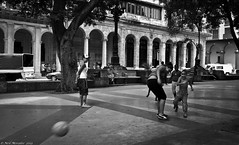 Football in the Street. (Neil. Moralee) Tags: street family bw white playing black monochrome ball children fun football shoot fifa soccer havana cuba games score manchesterunited comunist neilmoralee