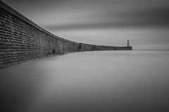 The Wall (Boyd Hunt) Tags: longexposure sea bw lighthouse water wall mono coast harbour tide horizon curve defence seaham