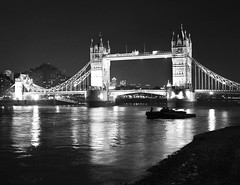 Tower Bridge at Night in London (` Toshio ') Tags: bridge light england blackandwhite bw reflection london tower english night towerbridge boat europe european angle unitedkingdom suspensionbridge europeanunion thamesriver cityoflondon toshio