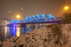 Langevin bridge on a snowy night (John in Calgary) Tags: longexposure blue snow canada calgary night canon reflections spring rocks downtown alberta bow 5d bowriver starbursts langevinbridge 1635mmf28lii jpandersenimages