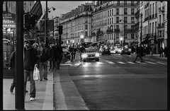 Paris at night: Nobody rules the street (Bourguiboeuf) Tags: street old city light people urban bw white black paris france slr film car bike night canon vintage french noir pavement 85mm f1 voiture nb iso 400 l mm analogue 12 135 35 rue et nuit blanc phare velo personne ville gens argentique passant pav troitoir pellicule kentmere bourguiboeuf