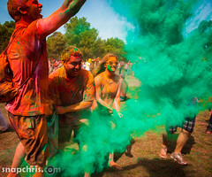green Gulal powder flies at Asha Stanford Holi Festival 2013 (tibchris) Tags: festival fun paint indian smiles stanford asha holi 2013 snapchris