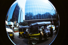 Rickshaw Passenger (raspberry dolly) Tags: india film lomography fisheye mumbai lomofisheye