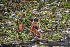 Taytay Sea, Tondo - The beach 'resort' at Charcoal Factory. (Mio Cade) Tags: boy water girl swim kid garbage philippines dirty rubbish manila sick liver virus sanitation scavenger jaundice taytay hepatitis tondo