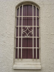 Vestibule Window Detail of St Johns Anglican Church  Downey Street, Alexandra (raaen99) Tags: door roof roses flower building tree tower church window wall architecture facade garden tile concrete religious town leaf 1930s worship catholic exterior terracotta painted faith country religion entrance stjohns australia chapel victoria belltower doorway belfry alexandra porch catholicism 20thcentury grounds stainedglasswindow anglican stucco 30s 1937 anglicanchurch churchbuilding rooftile placeofworship spanishmission countryvictoria vestibule twentiethcentury countrytown hippedroof northeastvictoria religiousbuilding stjohnsanglicanchurch spanishmissionstyle spanishmissionarchitecture provincialvictoria georgepayne spanishmissionchurch terracottarooftile downeystreet architecturallydesigned lrwilliams spanishmissionbuilding downeyst alexandraanglicanchurch theanglicanchurchofstjohn georgeapayne stuccoedconcrete