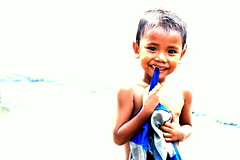 Pogi (Chassagne Yaoyao) Tags: street boy urban child philippines manila overexposed filipino streetchildren intramuros washedout