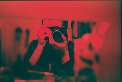 Self-portrait (Andrey Timofeev) Tags: camera red portrait selfportrait colour reflection film contrast 35mm dark bathroom mirror hands bokeh grain  screwmount     helios44 zenitttl  fujifilmsuperiaxtra400 redscale  redscaled 35    44   selfmaderedscale 42 homemaderedscale winter2012 39 m39tom42stepdownringadapter