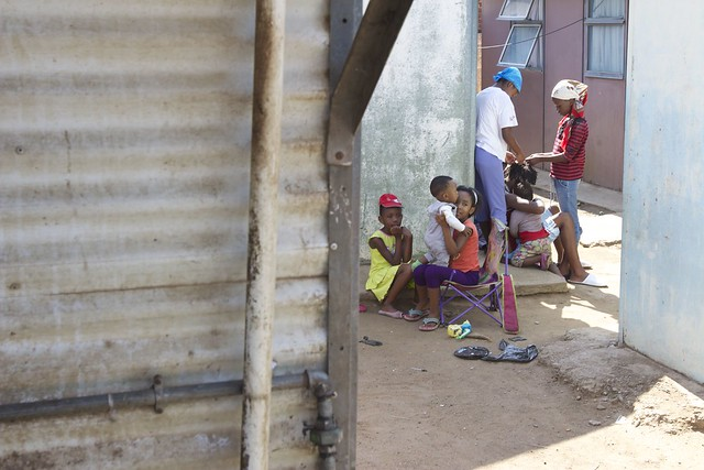 Children playing outside their house in Alexandra.