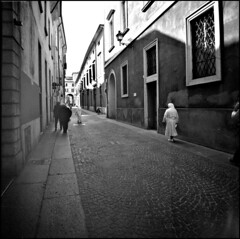 Diana Walk #1 (I is someone else) Tags: street camera white film rollei toy lomography strada italia lofi plastic diana 400 analogue brescia lombardia xtol suore pellicola noons rpx